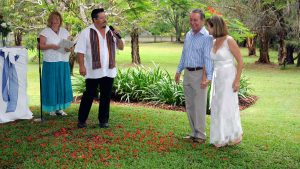 garden wedding ceremony with male and female celebrant