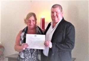 bride and groom holding their wedding certificate