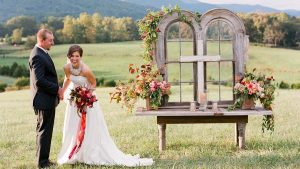 a country wedding ceremony with bride groom next to the alter
