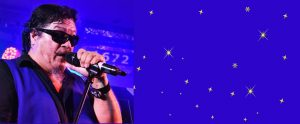 entertainment page header image with Kellsy performing on stage