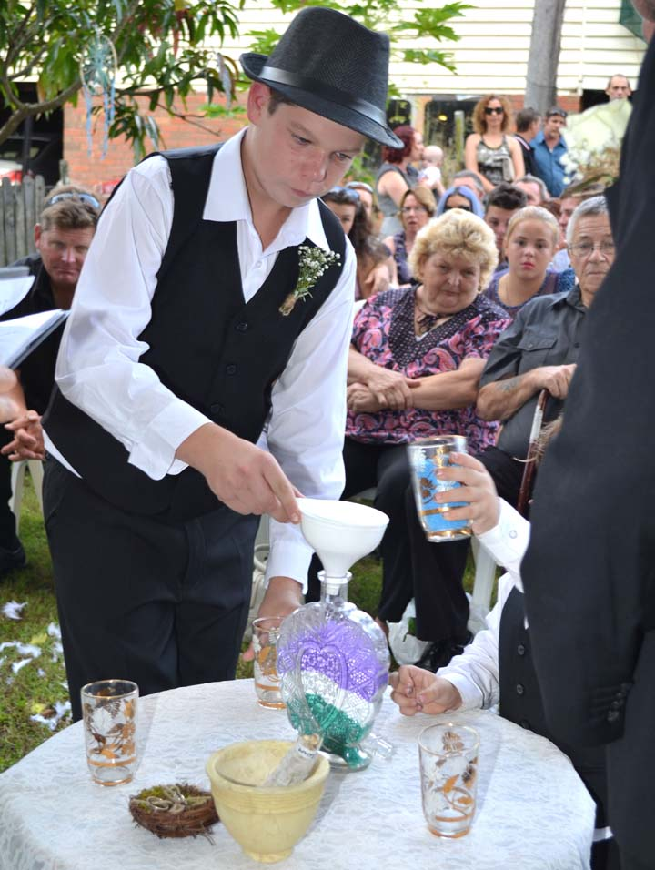 Celebrants2U Testimonials page image of Dylan and Finn pouring sand during wedding ceremony