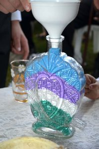 The Sand Wedding Ceremony Image showing the glass vessel almost full of different coloured sands