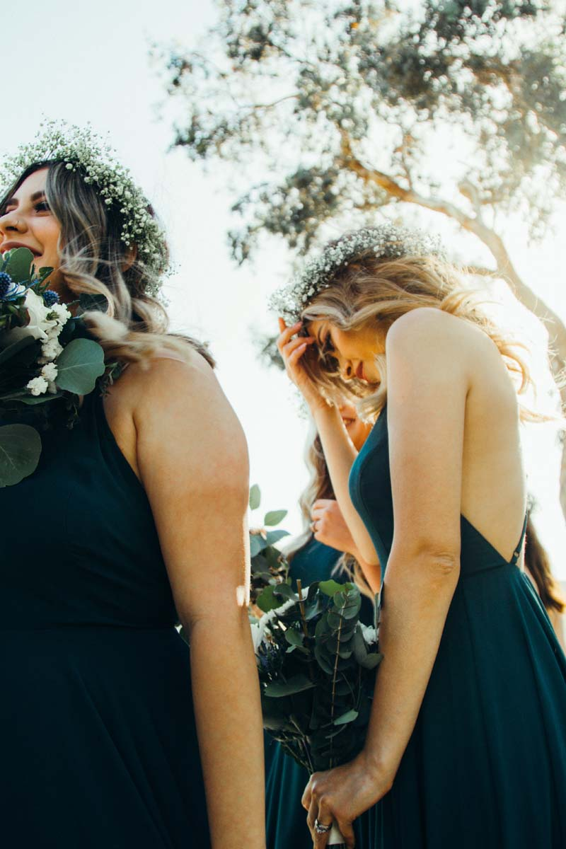 hints and tips about the wedding ceremony image of 2 bridesmaids with flowers in their hair