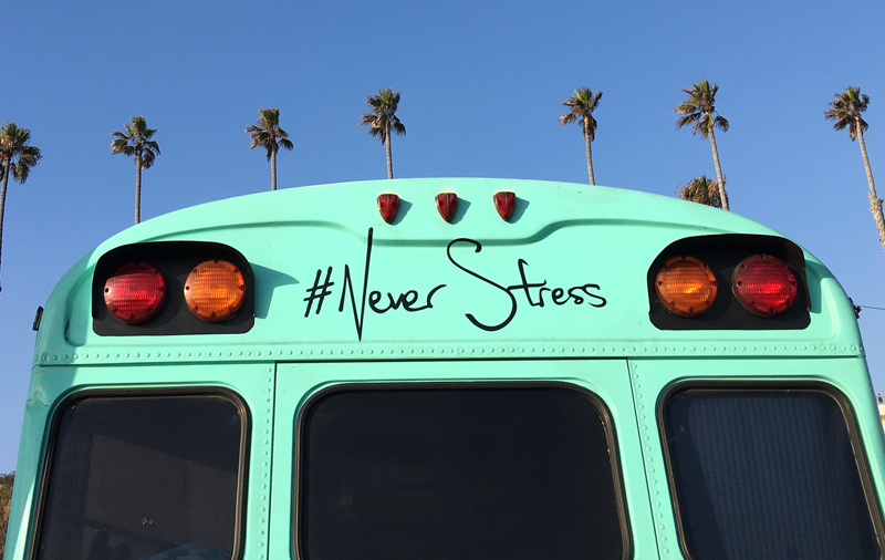 hints and tips managing stress image of bus and palm trees with quote #never stress