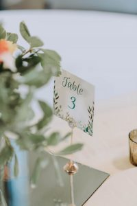 hints and tips planning the wedding reception image of table number card and setting