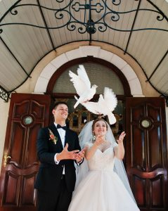 wedding ceremony image of the bride and groom doing white dove release